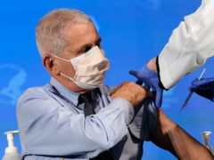 Dr Anthony Fauci receiving a vaccination (AP/Patrick Semansky, Pool, File)