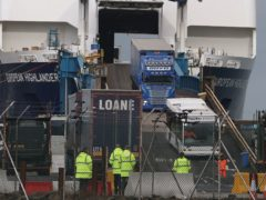 Lorries driving off the European Highlander P&O ferry at the Port of Larne (PA)