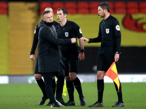 Wayne Rooney, left, speaks to the match officials after the game (Adam Davy/PA)
