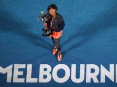 Naomi Osaka poses with the trophy after beating Jennifer Brady (Hamish Blair/AP)