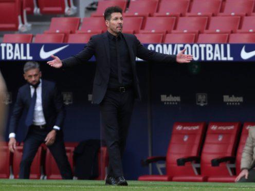 Diego Simeone's Atletico Madrid have had their lead cut at the top of LaLiga (Manu Fernandez/AP)