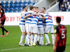 Todd Kane (hidden) celebrates QPR's winner with his team-mates (Tess Derry/PA)