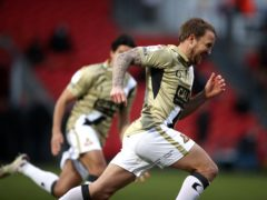 James Coppinger celebrates his late equaliser (Tim Goode/PA)
