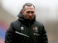 Michael Appleton's Lincoln remain top of League One (Tim Markland/PA)
