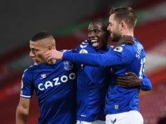 Gylfi Sigurdsson (right) celebrates with team mates Abdoulaye Doucoure and Richarlison after putting Everton 2-0 up at Anfield (Laurence Griffiths/PA)