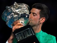 Serbia's Novak Djokovic kisses the Norman Brookes Challenge Cup after defeating Russia's Daniil Medvedev in the men's singles final at the Australian Open tennis championship in Melbourne, Australia, Sunday, Feb. 21, 2021.(AP Photo/Mark Dadswell)