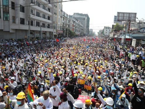 Anti-coup protesters join a rally in Mandalay, Myanmar (AP)