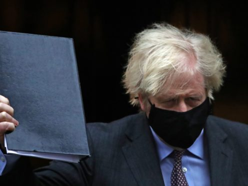 Prime Minister Boris Johnson leaving 10 Downing Street, London, to give his speech to Parliament where he will set out the road map for easing coronavirus restrictions across England (Aaron Chown/PA)