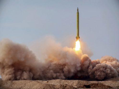 FILE – In this file photo released Jan. 16, 2021, by the Iranian Revolutionary Guard, a missile is launched in a drill in Iran. The Biden administration's early efforts to resurrect the 2015 Iran nuclear deal are getting a chilly early response from Tehran. Though few expected a breakthrough in the first month of the new administration, Iran's tough line suggests a difficult road ahead.(Iranian Revolutionary Guard/Sepahnews via AP, File)