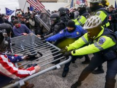 FILE – In this Jan. 6, 2021, file photo rioters try to break through a police barrier at the Capitol in Washington. Congress is set to hear from former security officials about what went wrong at the U.S. Capitol on Jan. 6. That's when when a violent mob laid siege to the Capitol and interrupted the counting of electoral votes. Three of the four testifying Tuesday resigned under pressure immediately after the attack, including the former head of the Capitol Police. Much is still unknown about the attack, and lawmakers are demanding answers. (AP Photo/John Minchillo, File)