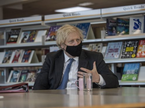 Prime Minister Boris Johnson meets with teachers in the library during a visit to Sedgehill School in Lewisham (Jack Hill/ The Times/PA)