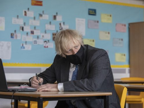 Prime Minister Boris Johnson during his visit to Sedgehill Academy (Jack Hill/The Times/PA)