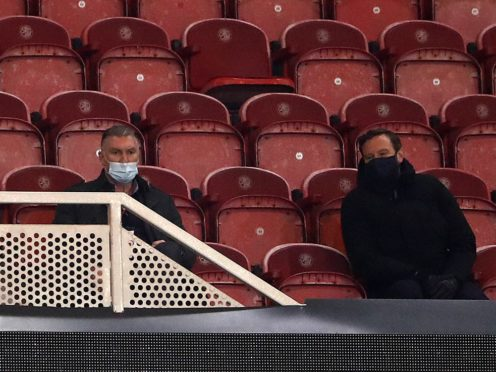 Nigel Pearson, left, watches his new side from the directors' box (Tim Goode/PA)