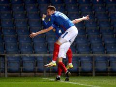 Harvey White (bottom) celebrates with team-mate Ronan Curtis (David Davies/PA)