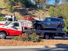 The vehicle driven by Tiger Woods on the back of a truck in Los Angeles (Keiran Southern/PA)