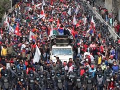 People in Nepal celebrate a court order demanding the reinstatement of Nepal's parliament (Niranjan Shrestha/AP)