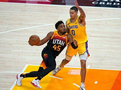 Utah Jazz guard Donovan Mitchell drives against Los Angeles Lakers forward Kyle Kuzma (Rick Bowmer/AP)