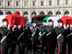 The coffins were draped with the Italian flag (Andrew Medichini/AP)