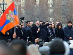 Prime Minister Nikol Pashinyan gestures to a crowd in Yerevan, Armenia (Hayk Baghdasaryan/PHOTOLURE via AP)