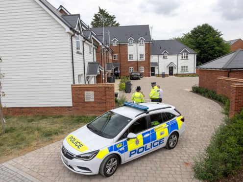 Police outside the house in Muggleton Road in Amesbury, Wiltshire (Steve Parsons/PA)