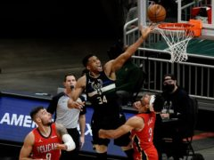 Milwaukee Bucks' Giannis Antetokounmpo shoots over New Orleans Pelicans' Josh Hart (Morry Gash/AP)