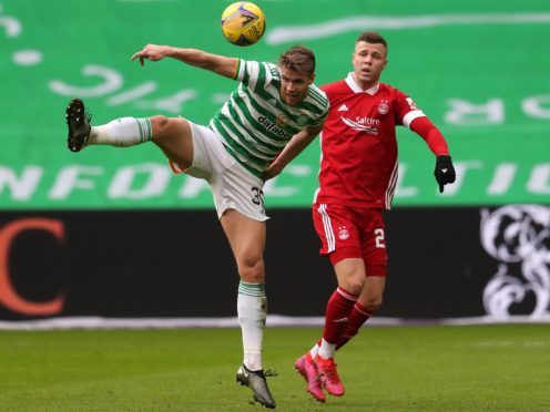 Celtic's Kristoffer Ajer (left) will attract interest says interim boss John Kennedy (Andrew Milligan/PA)