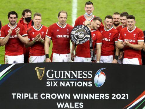 Wales celebrate winning the Triple Crown (David Davies/PA).
