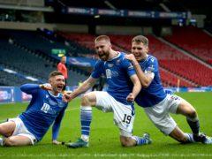 Shaun Rooney, centre, celebrates his goal (Andrew Milligan/PA)