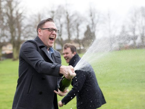 Gareth Bradley, left, and his partner Connor Dennis celebrate their win (National Lottery/ PA)