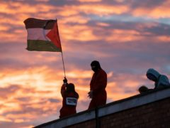 Rooftop protest at UAV Engines, Shenstone, Lichfield, Staffordshire, on February 23. (Vladimir Morozov/PA)