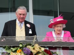 Lord Vestey and the Queen at the Investec Derby at Epsom Downs Racecourse in 2011 (David Davies/PA)