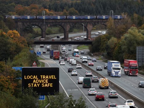 Environmental campaigners claim there is a 'lack of a clear plan' about how car journeys will be reduced by 20% (Andrew Milligan/PA)