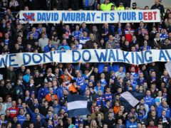 Rangers fans display banners at Ibrox (Lynne Cameron/PA)