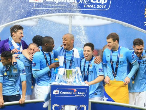 Manchester City celebrate their cup triumph (Nick Potts/PA)