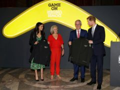 Harry and Meghan receive Invictus Games jackets from Malcolm Turnbull, then prime minister of Australia and his wife Lucy Turnbull, as they attend a reception at Australian High Commission in London, celebrating the forthcoming Invictus Games in 2018 (Alastair Grant/PA)