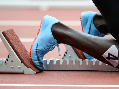 A general view of an athlete in the starting blocks (John Walton/PA)