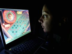 A woman uses an internet gambling website to play online roulette.