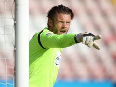Colchester goalkeeper Dean Gerken has a back problem (Adam Davy/PA)