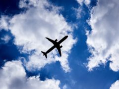 A silhouette of a plane as it passes overhead in Isleworth, West London (John Walton/PA)