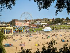 People on the beach at Barry Island, Wales (Ben Birchall/PA)