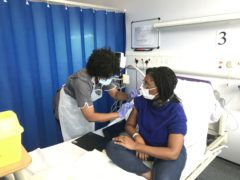 Minister for Equalities, Kemi Badenoch receiving her first vaccination as part of the Novavax phase 3 trial (PA)