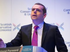 Douglas Ross plans to remain as an MP if he is elected to Holyrood in May (Colin D Fisher/Scottish Conservatives/PA)