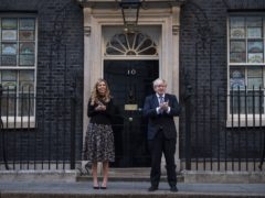 Prime Minister Boris Johnson and his fiancee outside 10 Downing Street (Victoria Jones/PA)