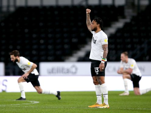 Derby's Colin Kazim-Richards stopped taking a knee after receiving racist abuse (Nigel French/PA)