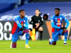 Wilfried Zaha takes the knee ahead of Crystal Palace's match with Sheffield United earlier this year (Catherine Ivill/PA)