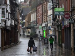 People walk up and down the High street in Winchester, Hampshire (Andrew Matthews/PA)