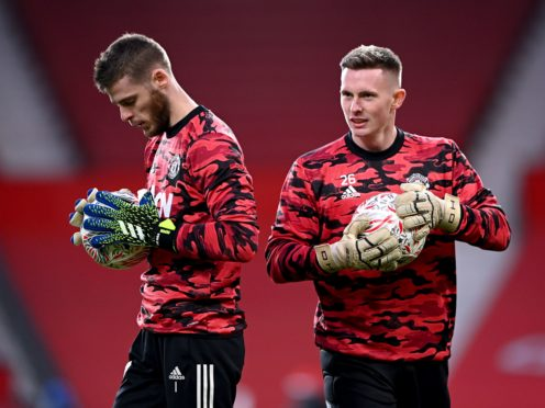 Dean Henderson will play against Manchester City with David De Gea absent (Laurence Griffiths/PA)