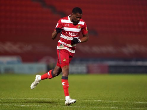 Doncaster Rovers' Fejiri Okenabirhie celebrates scoring their side's first goal of the game during the Sky Bet League One match at the Keepmoat Stadium, Doncaster. Picture date: Tuesday January 26, 2021.