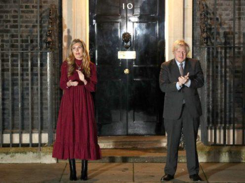 Carrie Symonds and Boris Johnson (Jonathan Brady/PA)