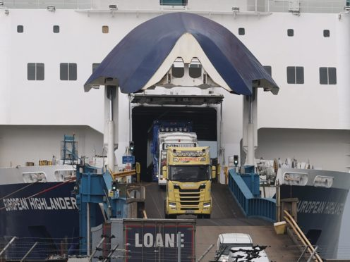 Lorries driving off the European Highlander P&O ferry at the Port of Larne. Picture date: Monday February 15, 2021.